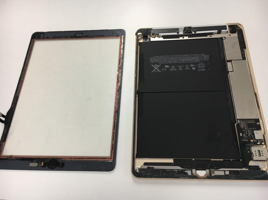 画面を剥がした乾燥中のiPad 第6世代